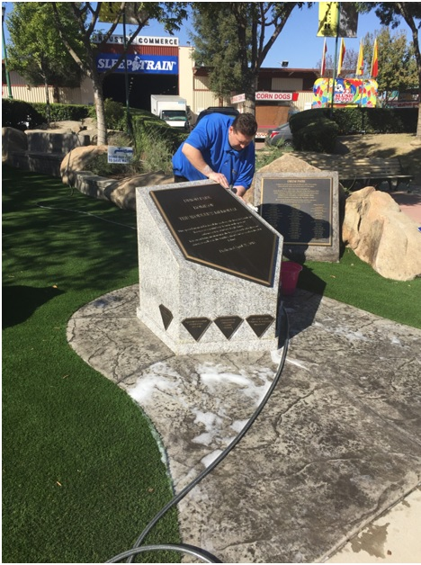Cleaning the monument for The Big Fresno Fair.